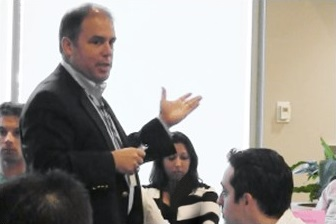 Peter DeMarco, founder of Priority Thinking, giving a presentation